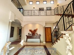 Foyer of luxury home with high ceilinng